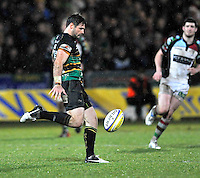 Northampton, England. Ben Foden of Northampton Saints clears the ball during the Aviva Premiership match between Northampton Saints and Harlequins at Franklin's Gardens on December 22. 2012 in Northampton, England.