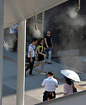 July 16, 2014, Tokyo, Japan - A mist curtain gives a relief to Tokyoites as an early summer heat bakes the nation's capital with the temperature soaring as high as nearly 90 degrees Fahrenheit.  (Photo by Natsuki Sakai/AFLO)