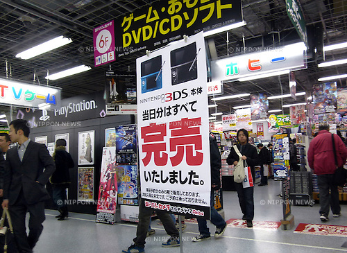 "Feb. 26, 2011 - Tokyo, Japan - A ""Sold Out"" sign is put up at the main entrance of a Tokyo discount store on the first day of Nintendo's 3DS launch on Saturday, Febraury 26, 2011. The Nintendo 3DS uses a 3.53-inch widescreen display with parallax barrier tech to create the 3D illusion. (Photo by Natsuki Sakai/AFLO)"
