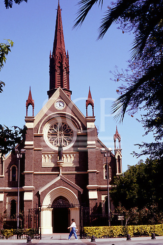 Santiago, Chile. Brick built church with ornate wooden spire.