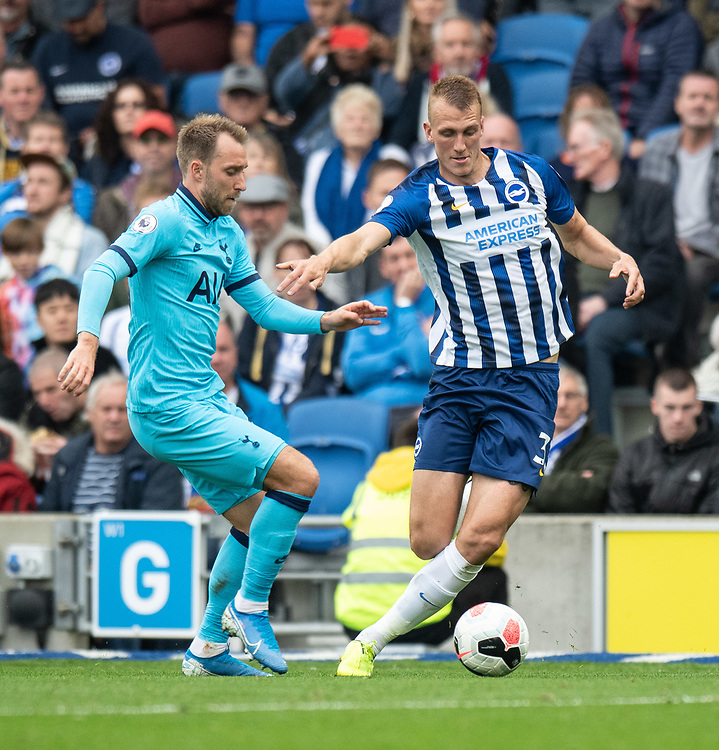 Brighton & Hove Albion's Dan Burn (right) under pressure from Tottenham Hotspur's Christian Eriksen (left)<br /> <br /> <br /> Photographer David Horton/CameraSport<br /> <br /> The Premier League - Brighton and Hove Albion v Tottenham Hotspur - Saturday 5th October 2019 - The Amex Stadium - Brighton<br /> <br /> World Copyright © 2019 CameraSport. All rights reserved. 43 Linden Ave. Countesthorpe. Leicester. England. LE8 5PG - Tel: +44 (0) 116 277 4147 - admin@camerasport.com - www.camerasport.com