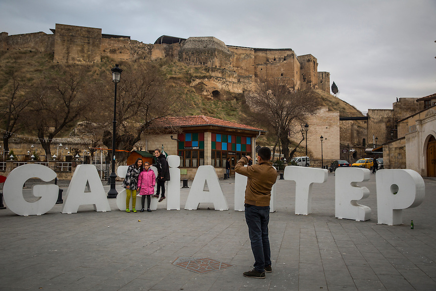 Taking a photo in front of the castle in the old city of Gaziantep, Turkey. The city feels familiar to Syrians escaping the war, since it has much in common, both culturally and aesthetically, with the Syrian city of Aleppo which lies 120 km to the south.