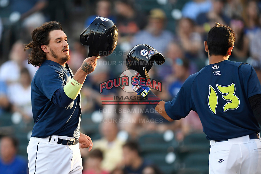 Left fielder Jay Jabs (7) of the Columbia Fireflies is congratulated by Andres Gimenez after scoring a run in a game against the Lexington Legends on Thursday, June 8, 2017, at Spirit Communications Park in Columbia, South Carolina. Columbia won, 8-0. (Tom Priddy/Four Seam Images)