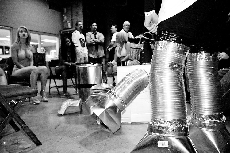 &quot;Robocop&quot; gets ready as Wingettes wait for him backstage at the 14th annual Wing Bowl, held in Philadelphia on February 3, 2006 at the Wachovia Center.<br /> <br /> The Wing Bowl is a competitive eating event in which eaters try and down the most hot wings in 30 total minutes in front of a crowd of 10,000 plus people.  The real show however is all around the eaters, from the various scantily clad women (known as &quot;Wingettes&quot;) that make up eaters' entourages, to the behavior of the fans themselves.