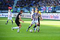 VOETBAL: HEERENVEEN: Abe Lenstra Stadion, SC Heerenveen - Vitesse, 21-01-2012, scheidsrechter Tom van Sichem, Guram Kashia (#37), Renato Ibarra (#30), Oussama Assaidi (#22), Eindstand 1-1, ©foto Martin de Jong