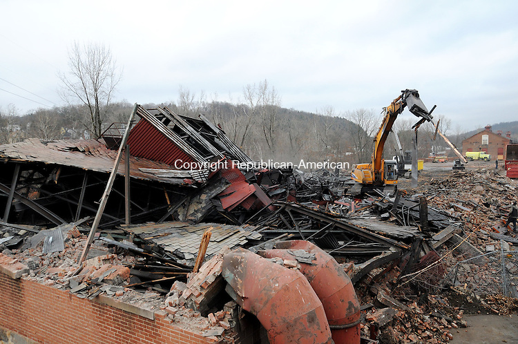 THOMASTON, CT, 22 NOV 13- 112213AJ01- A building at Plume & Atwood off East Main Street in Thomaston is   razed Friday by Winsted-based Mountaintop Trucking. Alec Johnson/ Republican-American