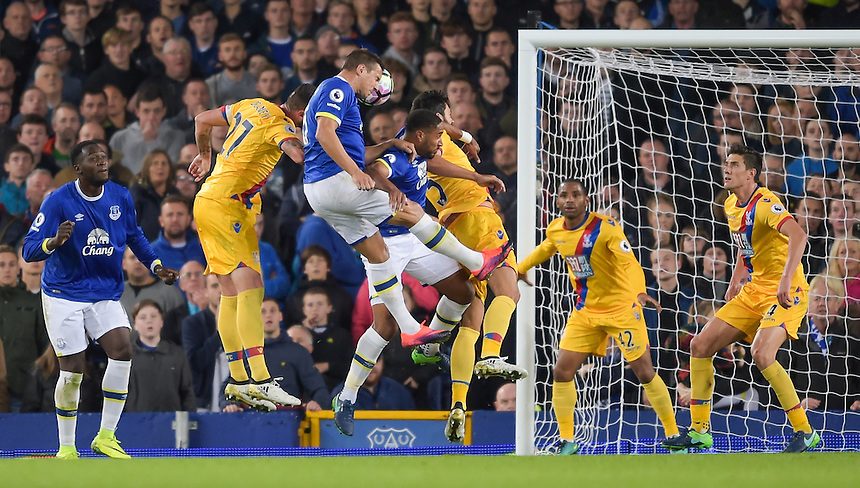 Everton's Phil Jagielka heads the ball towards goal<br /> <br /> Photographer Terry Donnelly/CameraSport<br /> <br /> The Premier League - Everton v Crystal Palace - Friday 30th September 2016 - Goodison Park - Liverpool<br /> <br /> World Copyright &copy; 2016 CameraSport. All rights reserved. 43 Linden Ave. Countesthorpe. Leicester. England. LE8 5PG - Tel: +44 (0) 116 277 4147 - admin@camerasport.com - www.camerasport.com