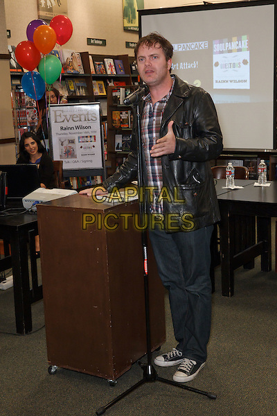 "RAINN WILSON.Rainn Wilson signs copies of his new book, ""Soul Pancake,"" at Barnes & Noble Huntington Beach, Huntington Beach, CA, USA. .November 18th, 2010.booksigning full length jeans denim check shirt black leather microphone hand.CAP/CEL.©CelPh/Capital Pictures."