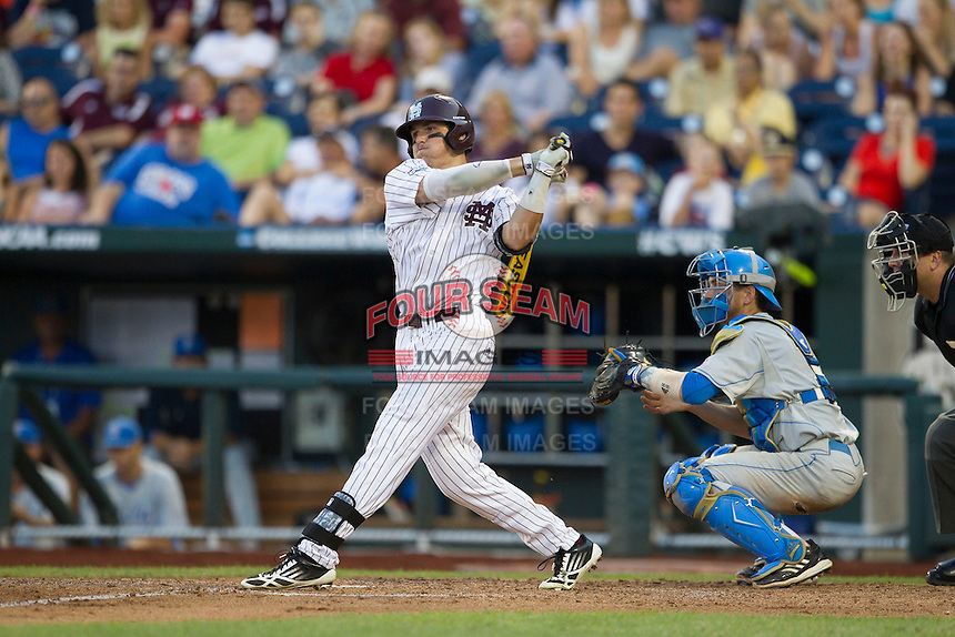 Mississippi State outfielder Hunter Renfro (34) follows through on his swing during Game 1 of the 2013 Men's College World Series Finals against the UCLA Bruins on June 24, 2013 at TD Ameritrade Park in Omaha, Nebraska. The Bruins defeated the Bulldogs 3-1, taking a 1-0 lead in the best of 3 series. (Andrew Woolley/Four Seam Images)