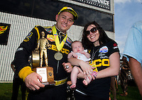 Sept. 1, 2014; Clermont, IN, USA; NHRA top fuel dragster driver Richie Crampton celebrates with daughter Emma Crampton and girlfriend Stephanie Laski after winning the US Nationals at Lucas Oil Raceway. Mandatory Credit: Mark J. Rebilas-USA TODAY Sports