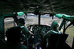 "Flight instructor Jerry Borchin, seated in the left front seat, brings a Bell UH-1 ""Huey"" helicopter in for a landing during a search-and-rescue training flight over Flagler County, Fla., Tuesday, Nov. 16, 2004.(Brian Myrick)"