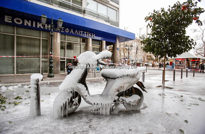 Pictured: Thick ice forms on a scooter in central Salonika, Greece. Monday 09 January 2017<br /> Re: Severe cold weather affects Salonica in northern Greece