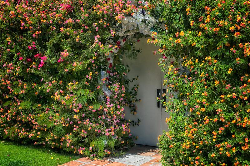 Door covered in flowers.