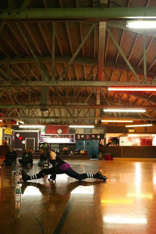February 19, 2008; Santa Cruz, CA, USA; A skater stretches during Santa Cruz Rollergirls practice in Santa Cruz, CA. Photo by: Phillip Carter