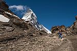 Hiker walking on trail to the Matterhorn, 4477m, Zermatt Alpine Resort, Valais, Switzerland, Europe
