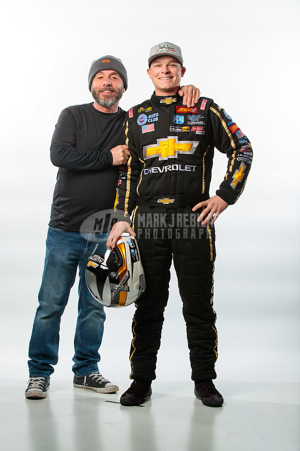 Feb 6, 2019; Pomona, CA, USA; NHRA top fuel driver Austin Prock (right) poses for a portrait with photographer Gary Nastase during NHRA Media Day at the NHRA Museum. Mandatory Credit: Mark J. Rebilas-USA TODAY Sports