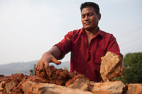 A man rebuilds his house with mud and stones near at Kathmandu, Nepal. May 8, 2015