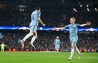 Kevin De Bruyne of Manchester City celebrates with Ilkay Gundogan of Manchester City as he scores his second goal making it 3 1 during the UEFA Champions League match between Manchester City and Barcelona at the Etihad Stadium, Manchester, England on 1 November 2016. Photo by Andy Rowland / PRiME Media Images.
