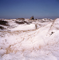 Snow coats the sand dunes at North Light on Block Island