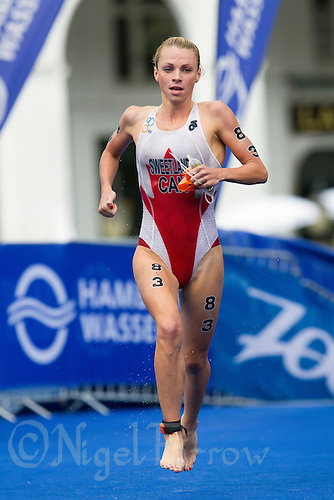 13 JUL 2014 - HAMBURG, GER - Kirsten Sweetland (CAN) from Canada heads for transition at the end of her swim at the 2014 ITU World Mixed Relay Championships in the Altstadt Quarter, Hamburg in  Germany (PHOTO COPYRIGHT © 2014 NIGEL FARROW, ALL RIGHTS RESERVED)