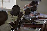A student prays before taking a mid-term exam in the library of the Solidarity Teacher Training College (STTC) in Yambio, South Sudan. The STTC is run by Solidarity with South Sudan, an international network of Catholic groups working to train teachers, health workers and pastoral agents throughout the African country.