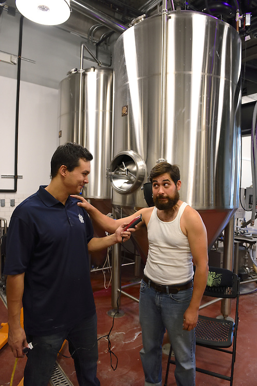 Coney Island Brewery's brewmaster getting his beard shaved off.