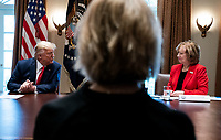 United States President Donald J. Trump, left, speaks to Debbie Hatmaker, right, Chief Nursing Officer of the ANA Enterprise, as he holds a meeting with nurses on the COVID-19 response at the White House in Washington, DC, March 18, 2020, in Washington, D.C. <br /> Credit: Kevin Dietsch / Pool via CNP/AdMedia