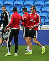 CARDIFF, WALES - SEPTEMBER 05: Gareth Bale (R) warms up prior to the Wales training session, ahead of the UEFA Euro 2016 qualifier against Israel, at the Cardiff City Stadium on September 5, 2015 in Cardiff, Wales.