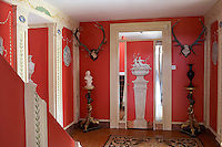 Red entrance hall inspired by Diana the Huntress and other mythological themes, Loughcrew House, County Meath, Ireland