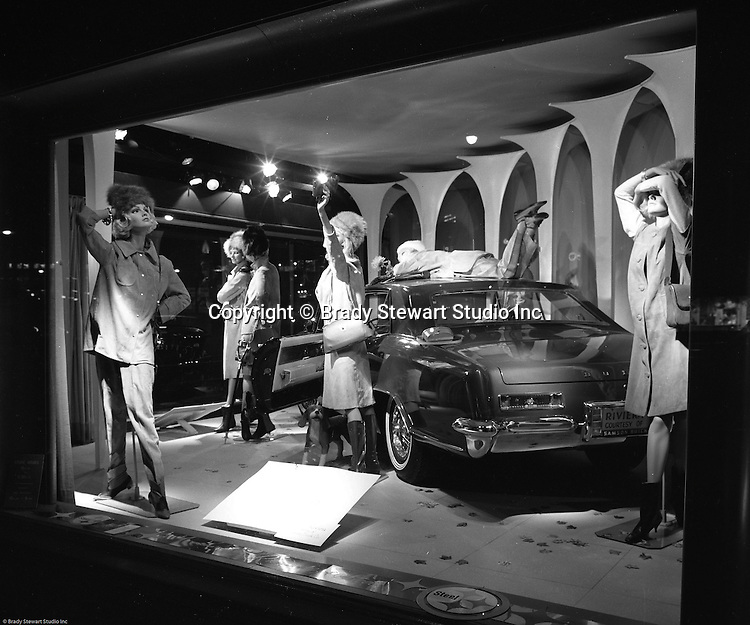 Pittsburgh PA: View of Christmas window display at Horne's department store in downtown Pittsburgh. New Buick Riviera on display during the Rhapsody of Steel campaign. US Steel launched an awareness campaign of all the current uses of steel in everyday products.  During this time, ALCOA Aluminum Company of America also headquartered in Pittsburgh, was aggressively competing to enter markets where US  steel companies traditional dominated market share. Examples included beer and food Cans, appliances, automobile parts, children toys / bicycles, and more.