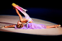 Maryia Yushkevich of Belarus flexibility to finish handsfree gala exhibition in chiffon at 2006 Portimao World Cup of Rhythmic Gymnastics on September 10, 2006 at Portimao, Portugal.  (Photo by Tom Theobald)