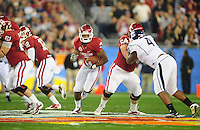 Jan. 1, 2011; Glendale, AZ, USA; Oklahoma Sooners running back (7) DeMarco Murray runs the ball in the first quarter against the Connecticut Huskies in the 2011 Fiesta Bowl at University of Phoenix Stadium. Mandatory Credit: Mark J. Rebilas-