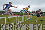 Niall ORiordan (Marian Park/Manor) clears the hurdle in front of Eoin OCarroll (Spa/Muckross) and Kieran Moss (Strand Road) at the Community Games County finals at An Riocht Track, Castleisland, last Saturday..