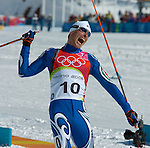 2/26/06 -- The 2006 Torino Winter Olympics -- Pragelato , Italy. -- Cross-Country Men's 50 KM -- .Giorgio di Centa of Italy celebrates his win in the 50km mass start cross country race in Pragelato Plan, Italy...Photo by Scott Sady, USA TODAY staff.