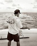 USA, Florida, fisherman prepping casting net to catch bait fish, Islamorada (B&W)