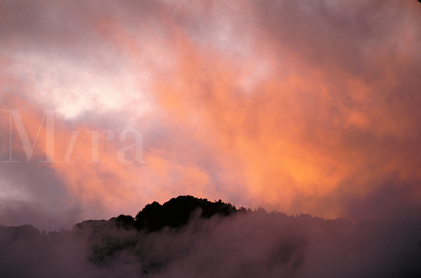 Sunset clouds over mountain. Washington USA Mt. Baker-Snoqualmie National Forest.