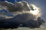 Cumulonimbus thunderstorm clouds at sunset, near Rio Vista, Solano County, California