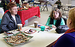 WATERTOWN CT. 30 December 2017-123017SV02-From left, Pat Damelia of Watertown, Patty Olivieri of Thomaston, and Debi Thompson of Terryville chat while eating cookies during the annual holiday cookie party at New Hope Anglican Church in Watertown Saturday.<br /> Steven Valenti Republican-American