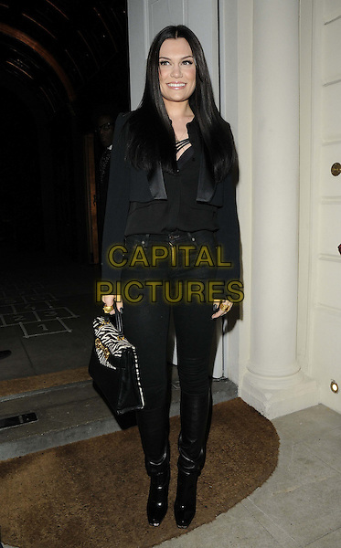 Jessie J (Jessica Ellen Cornish).The London Collections: Men GQ Dinner, Sketch bar & restaurant, Conduit St., London, England..January 9th, 2013.full length black jacket jeans denim top zebra white animal print bag purse  .CAP/CAN.©Can Nguyen/Capital Pictures.