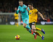 11th February 2019, Molineux, Wolverhampton, England; EPL Premier League football, Wolverhampton Wanderers versus Newcastle United; Diogo Jota of Wolverhampton Wanderers takes on Florian Lejeune of Newcastle United