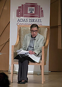 """Associate Justice of the Supreme Court of the United States Ruth Bader Ginsburg reads a passage from """"The Diary of Anne Frank"""" as she appears at Adas Israel Congregation in Washington, DC on Thursday, February 1, 2018.<br /> Credit: Ron Sachs / CNP"""