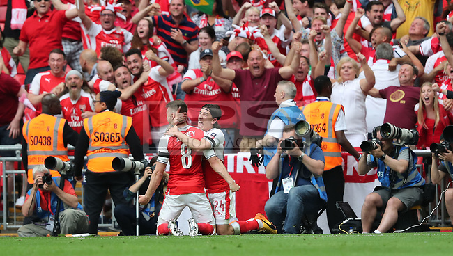 Aaron Ramsey (L) of Arsenal scores the second goal for Arsenal during the FA Cup Final match between Arsenal v Chelsea, Wembley stadium, London on 27th May 2017
