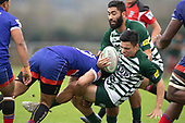 Jesse Pascoe is hit hard by Latiume Fosita. Counties Manukau Premier Club Rugby game between Ardmore Marist and Manurewa, played at Bruce Pulman Park Papakura on Saturday May 12th 2018. Ardmore Marist won the game 20 - 3 after leading 17 - 3 at halftime.<br /> Ardmore Marist - Katetistoti Nginingini try, penalty try, Latiume Fosita conversion, Latiume Fosita 2 penalties.<br /> Manurewa - Logan Fonoti penalty.<br /> Photo by Richard Spranger.