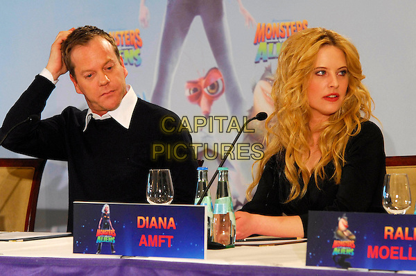 "KIEFER SUTHERLAND & DIANA AMFT.Photocall for ""Monsters vs. Aliens"", Hotel Adlon, Berlin, Germany..March 10th, 2009.half length black top sitting microphone hand on head .CAP/PPG/NK.©Norbert Kesten/People Picture/Capital Pictures"