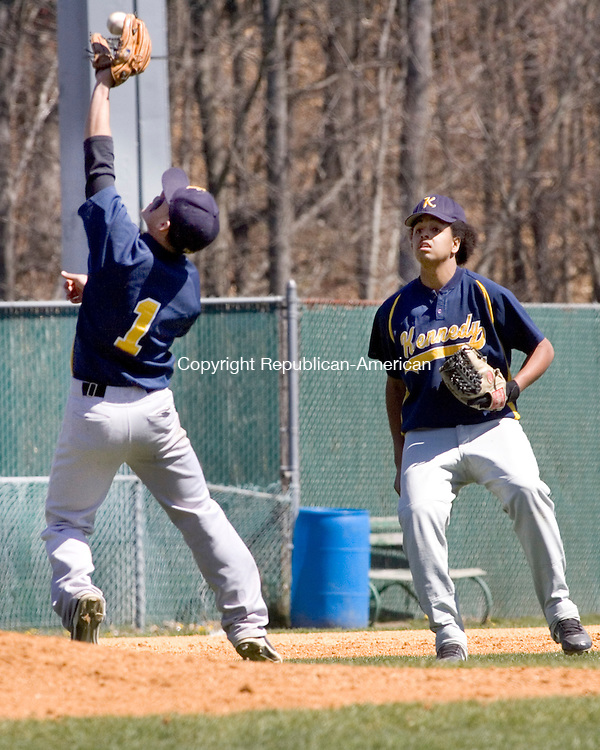 WATERBURY, CT. 07 April 2012-040712SV03-#1 Joel Acosta of Kennedy High makes an infield catch while being backed up by teammate #7 Jariol Gomez during baseball action against Wamogo High at Municipal Stadium in Waterbury Saturday..Steven Valenti Republican-American