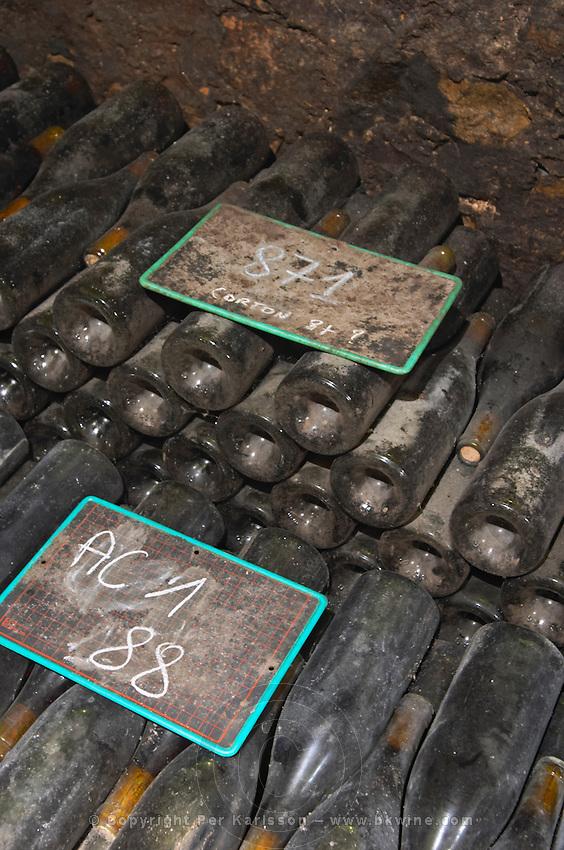 old bottles in the cellar chalk board domaine comte senard aloxe-corton cote de beaune burgundy france