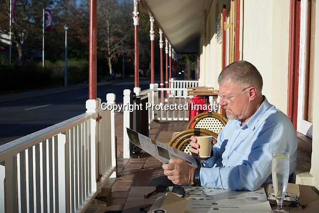STELLENBOSCH, SOUTH AFRICA - JUNE 6: Bestselling South African Crime author (thriller novelist) Deon Meyer reads a newspaper at a local restaurant in Stellenbosch outside Cape Town South Africa. Mr. Meyer's books has been translated to 28 languages. (Photo by: Per-Anders Pettersson)