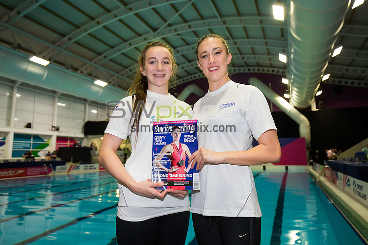 Picture by Rogan Thomson/SWpix.com - 06/12/2015 - Aquatics - 2015 ASA National Age Group Synchronised Swimming Championships - GL1 Leisure Centre, Gloucester, England - Jodie Cowie and Katie Clark from the England Talent Team pose with a copy of Swimming Times.