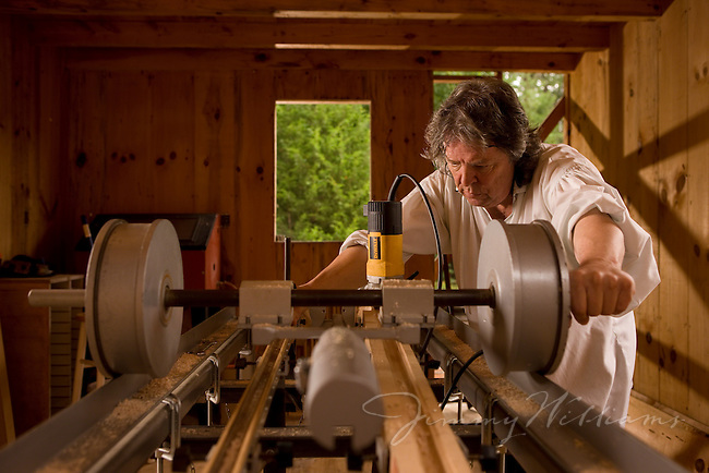 North Carolina gun and guitar maker, Bobby Denton, uses a table saw in his home workshop.
