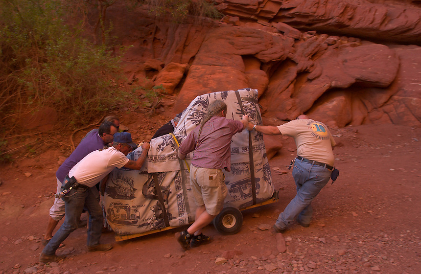 Movers unload brand-new Steinway concert grand piano from the bow of a Colorado River boat at a natural red rock grotto in the canyon wall. The Piano was played in an annual benefit concert for the Moab Music Festival in Moab, Utah, Thursday, Sept. 16, 2004. Performers included Paquito D'Rivera, Paul Hersh and Mark Summer. (Kevin Moloney for the New York Times)